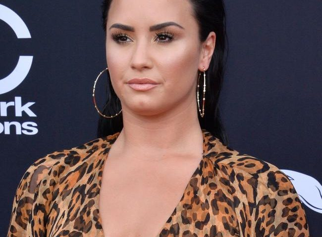 Demi Lovato promotes self-love with new tattoo